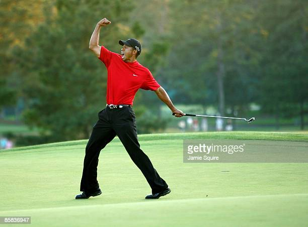 Tiger Woods celebrates after sinking a putt on the first playoff hole to win the 2005 Masters on April 10, 2005 at Augusta National Golf Course in...