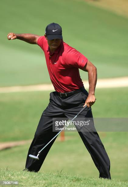 Tiger Woods celebrates his birdie putt on the eighth hole during the final round of the 89th PGA Championship at the Southern Hills Country Club on...