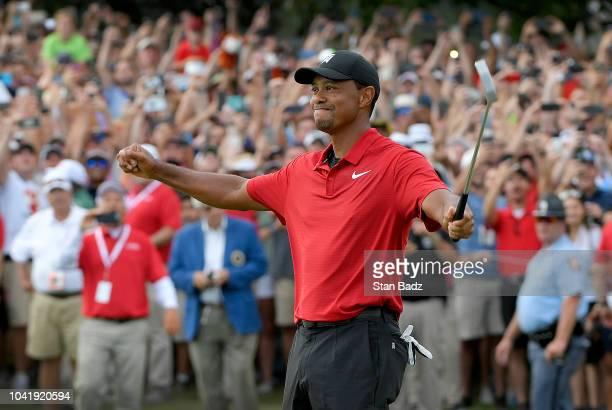 Tiger Woods celebrates his win after the final round of the TOUR Championship at East Lake Golf Club on September 23 in Atlanta Georgia