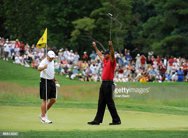 Tiger Woods celebrates his win on the 18th green after the final round of the ATT National at Congressional Country Club on July 5 2009 in Bethesda...
