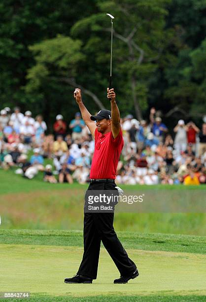 Tiger Woods celebrates his win on the 18th green after the final round of the AT&T National at Congressional Country Club on July 5, 2009 in...