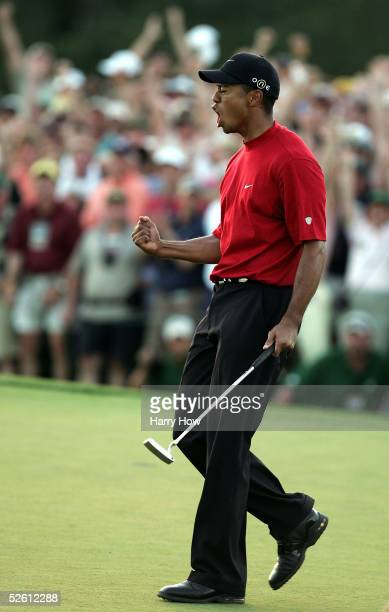 Tiger Woods celebrates holing out for birdie to defeat Chris DiMarco in a sudden death playoff during the final round of The Masters at the Augusta...