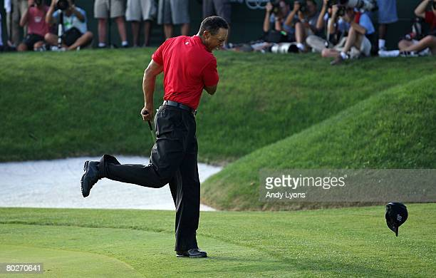 Tiger Woods celebrates making a birdie on the 18th green to win the Arnold Palmer Invitational on March 16, 2008 at the Bay Hill Club and Lodge in...