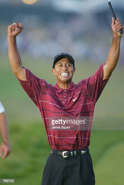 Tiger Woods celebrates on the 18th green after sinking the final putt to win the 102nd US Open on the Black Course at Bethpage State Park in...