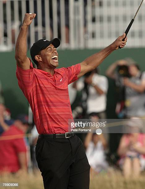 Tiger Woods celebrates on the 18th green after winning the 135th Open Championship at Royal Liverpool Golf Club in Hoylake Great Britain on July 23...