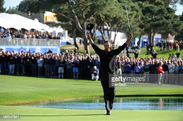 Tiger Woods celebrates on the 18th green after winning the Farmers Insurance Open at Torrey Pines Golf Course on January 28, 2013 in La Jolla,...