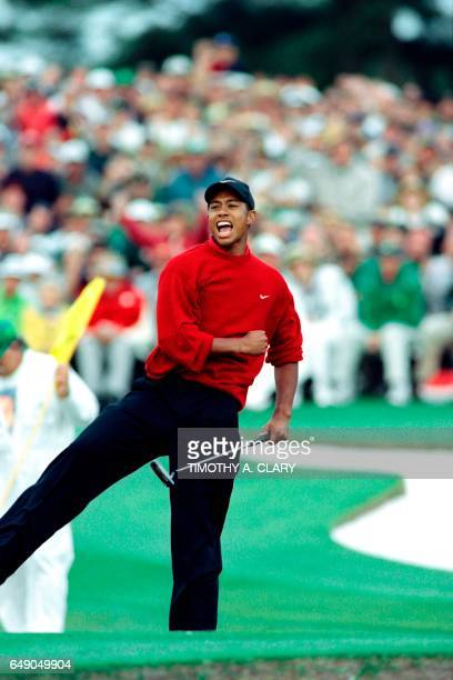 Tiger Woods celebrates on the eighteenth green after winning the 1997 Masters tournament at Augusta National Golf Club in Georgia on April 13 1997...