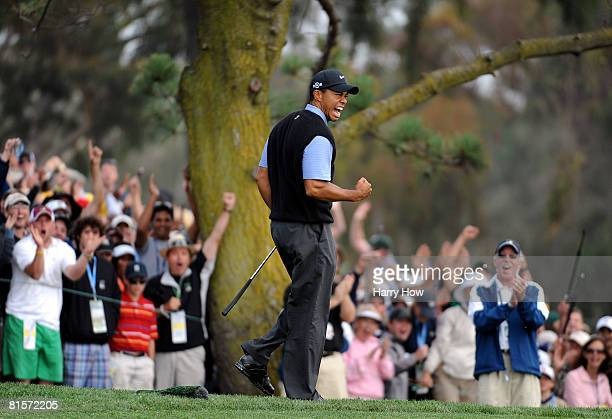 Tiger Woods celebrates sinking his long eagle putt on the 13th hole during the third round of the 108th US Open at the Torrey Pines Golf Course on...