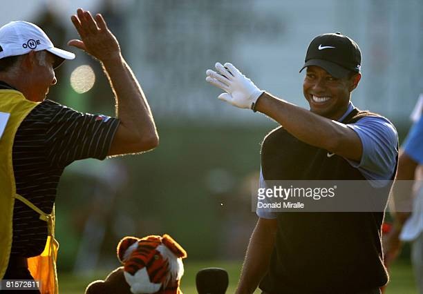 Tiger Woods celebrates sinking his long eagle putt on the 18th hole during the third round of the 108th US Open at the Torrey Pines Golf Course on...