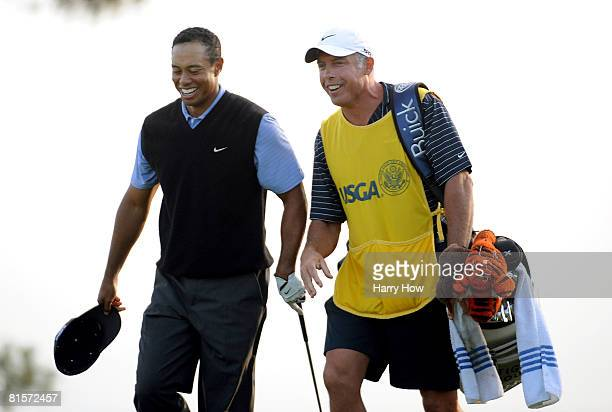 Tiger Woods celebrates with his caddie Steve Williams after making a birdie on the 17th hole during the third round of the 108th US Open at the...