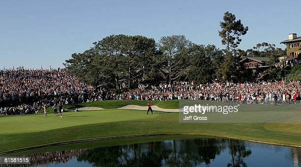 Tiger Woods celebrates with his caddie Steve Williams after sinking his birdie putt on the 18th green to force a playoff with Rocco Mediate during...