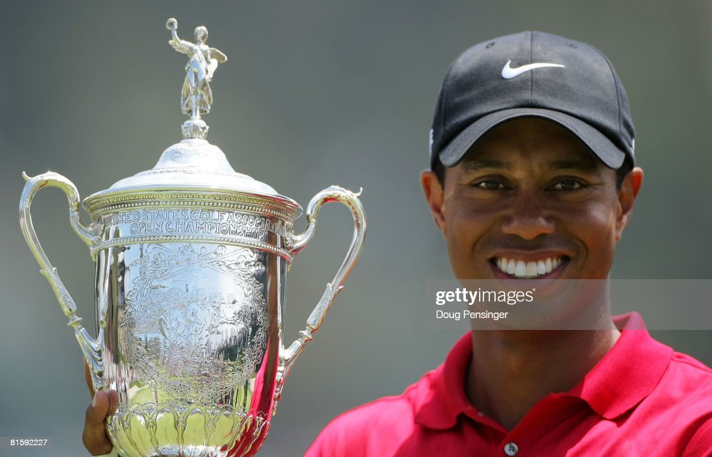 Tiger Woods celebrates with the trophy after winning on the first sudden death playoff hole during the playoff round of the 108th U.S. Open at the Torrey Pines Golf Course (South Course) on June 16, 2008 in San Diego, California.