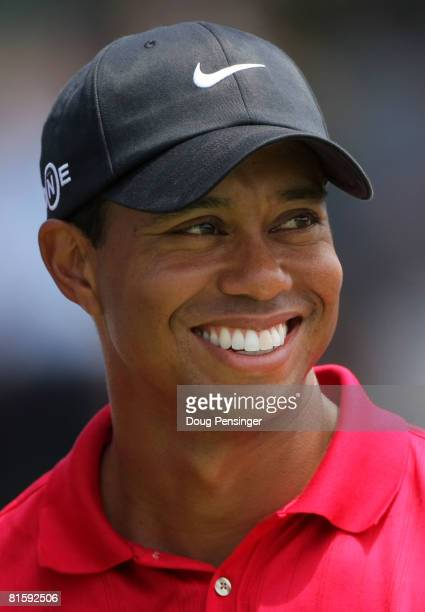 Tiger Woods celebrates with the trophy after winning on the first sudden death playoff hole during the playoff round of the 108th US Open at the...