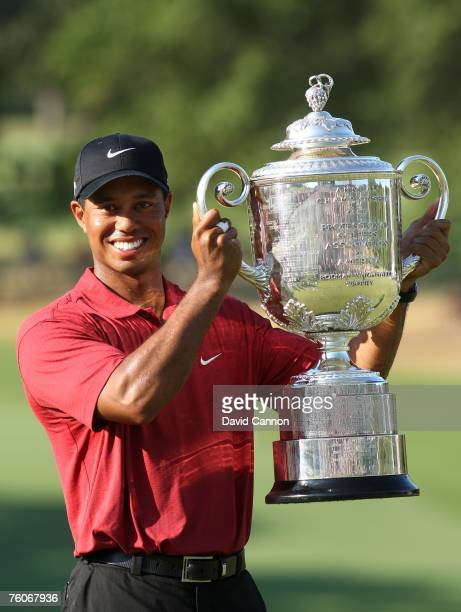 Tiger Woods celebrates with the Wanamaker Trophy after his twostroke victory at the 89th PGA Championship at the Southern Hills Country Club on...