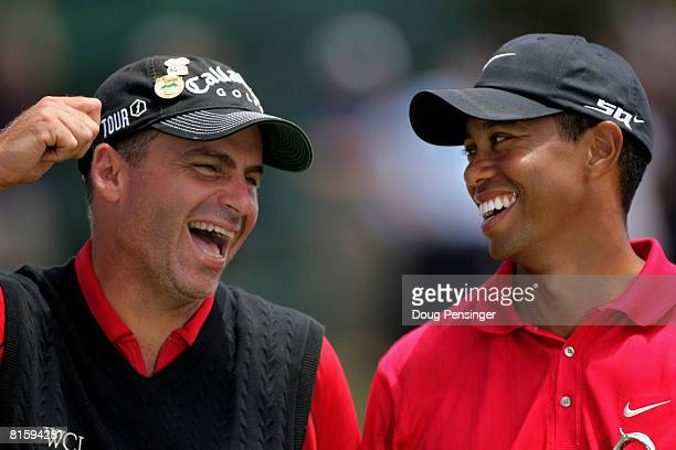 Tiger Woods champion and Rocco Mediate runner up share a moment on the 18th green during the trophy presentation after the playoff round of the 108th...