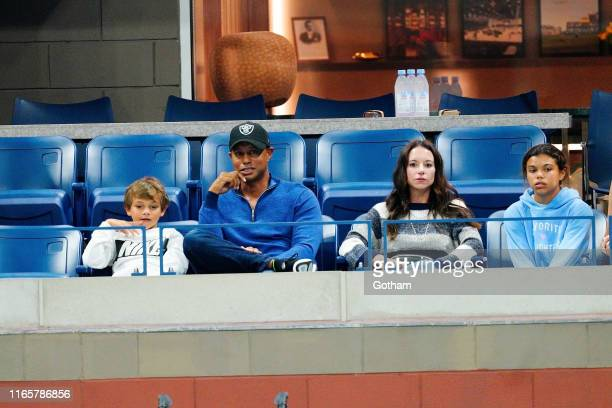 Tiger Woods, Charlie Axel Woods and Erica Herman cheer on Rafael Nadal at 2019 US Open in New York City.