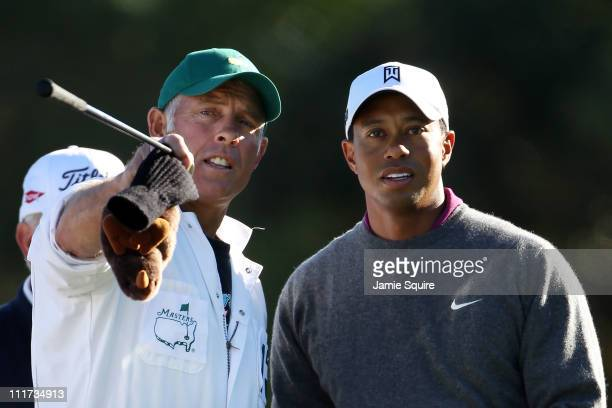 Tiger Woods chats with his caddie Steve Williams during a practice round prior to the 2011 Masters Tournament at Augusta National Golf Club on April...
