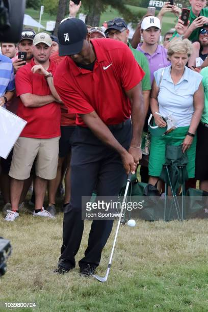 Tiger Woods chips onto the green on the 17th hole during the final round of the Tour Championship on September 23 at East Lake Golf Club in Atlanta GA