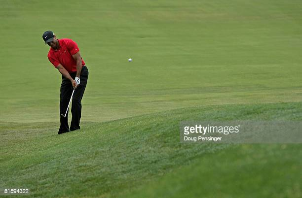 Tiger Woods chips onto the green with his third shot on the 12th hole during the playoff round of the 108th US Open at the Torrey Pines Golf Course...