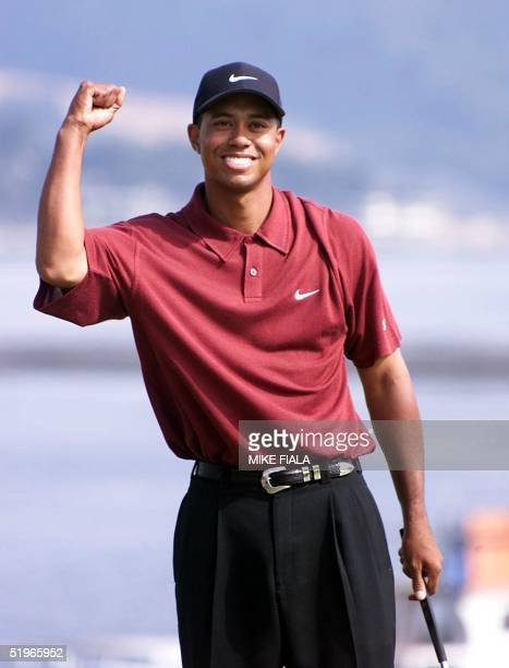 Tiger Woods clinches his fist after winning the US Open at Pebble Beach California 18 June 2000 Woods won with a score 12underpar AFP PHOTO MIKE FIALA