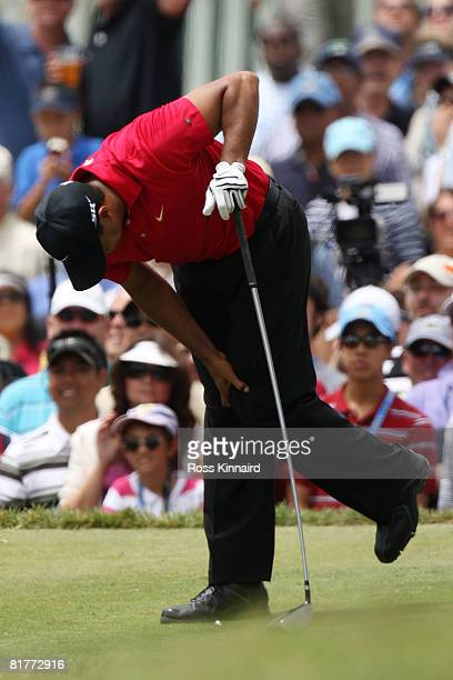Tiger Woods clutches his knee during the final round of the 108th US Open at the Torrey Pines Golf Course on June 15 2008 in San Diego California