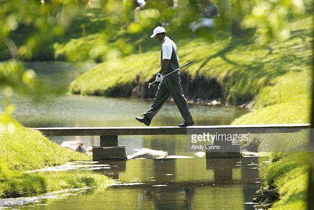 Tiger Woods crosses a bridge during the first round of the Memorial Tournament at Muirfield Village GC on May 23 2002