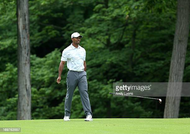 Tiger Woods drops his club after a poor second shot on the par 5 15th hole during the third round of the Memorial Tournament presented by Nationwide...