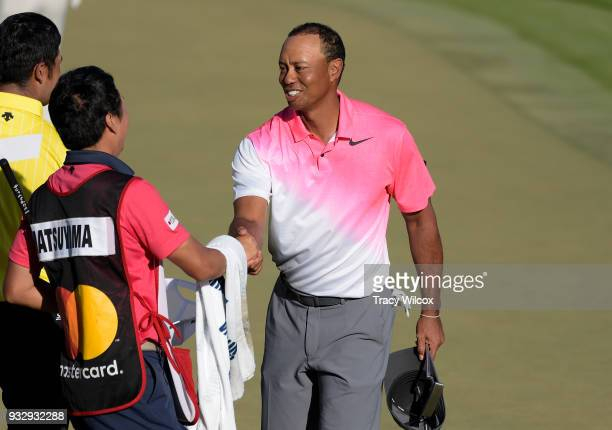 Tiger Woods finishes his round during the second round of the Arnold Palmer Invitational presented by MasterCard at Bay Hill Club and Lodge on March...