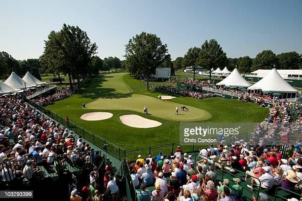 Tiger Woods finishes up on the 18th green during the final round of the World Golf Championships-Bridgestone Invitational at Firestone Country Club...