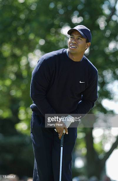 Tiger Woods follows his ball off the second tee during the third round on August 17, 2002 for the PGA Championship at Hazeltine National Golf Club in...