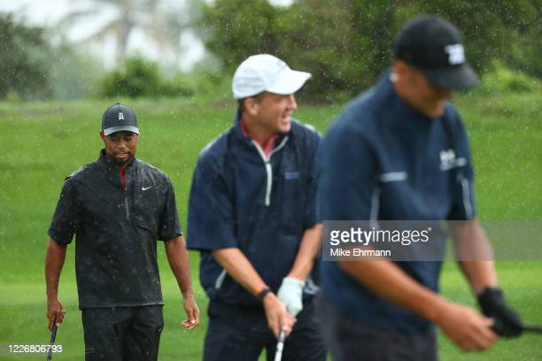 Tiger Woods. Former NFL player Peyton Manning and NFL player Tom Brady of the Tampa Bay Buccaneers warm up on the range prior to The Match: Champions...