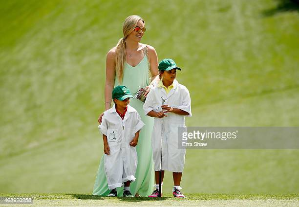 Tiger Woods' girlfriend Lindsey Vonn, son Charlie and daughter Sam watch the play during the Par 3 Contest prior to the start of the 2015 Masters...