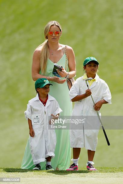 Tiger Woods' girlfriend Lindsey Vonn son Charlie and daughter Sam watch the play during the Par 3 Contest prior to the start of the 2015 Masters...