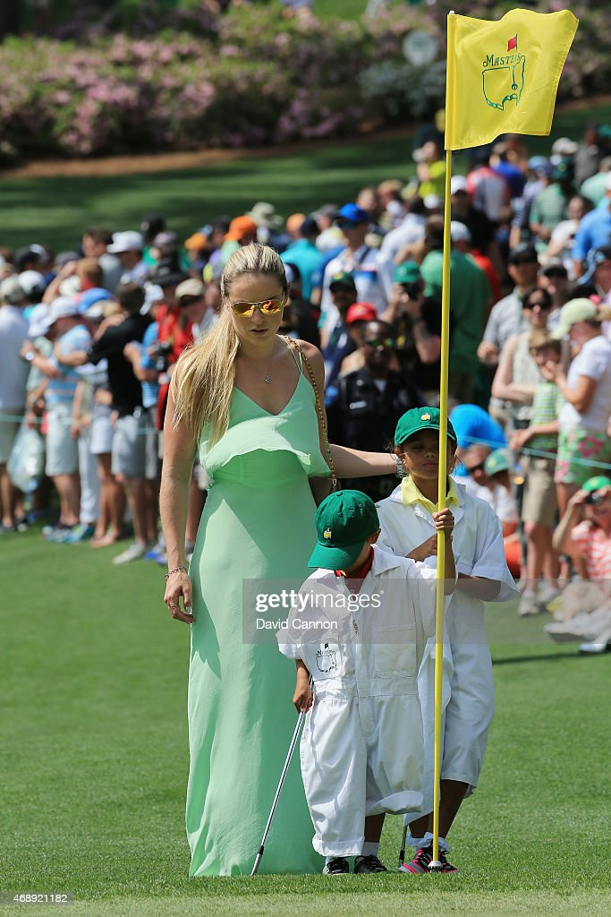 Tiger Woods' girlfriend Lindsey Vonn, son Charlie and daughter Sam watch the play during the Par 3 Contest prior to the start of the 2015 Masters Tournament at Augusta National Golf Club on April 8, 2015 in Augusta, Georgia.