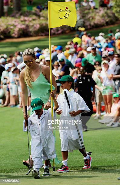 Tiger Woods' girlfriend Lindsey Vonn son Charlie and daughter Sam follow the play during the Par 3 Contest prior to the start of the 2015 Masters...