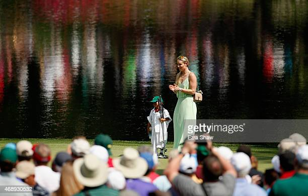 Tiger Woods' girlfriend Lindsey Vonn waits on a green with his son Charlie during the Par 3 Contest prior to the start of the 2015 Masters Tournament...