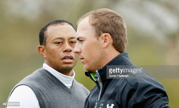 Tiger Woods greets Jordan Spieth on the ninth green after Woods shoot an 11over par 82 during the second round of the Waste Management Phoenix Open...