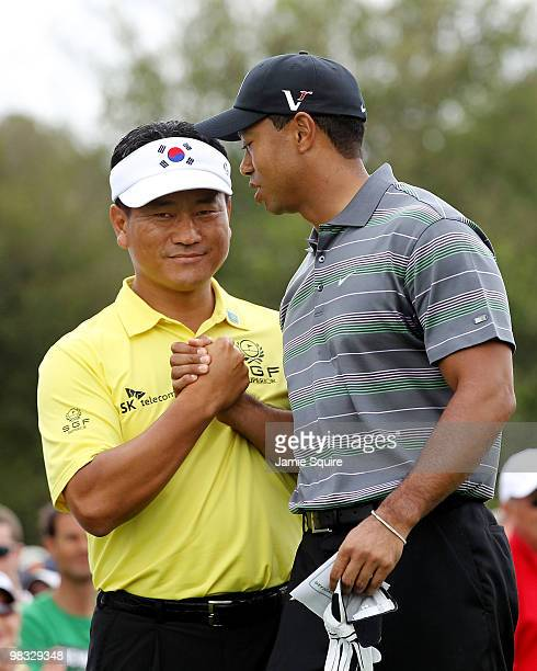 Tiger Woods greets KJ Choi of South Korea on the first tee during the first round of the 2010 Masters Tournament at Augusta National Golf Club on...