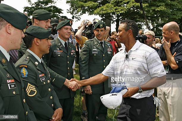 Tiger Woods greets members of the Armed Forces during the Opening Ceremony of the ATT National at Congressional Country Club on July 4 2007 in...