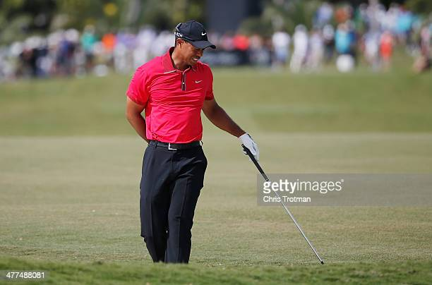 Tiger Woods grimages after playing a bunker shot on the fifth hole during the final round of the World Golf ChampionshipsCadillac Championship at...