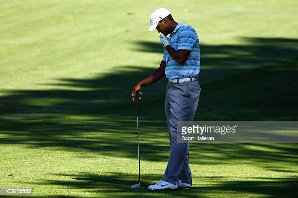 Tiger Woods hangs his head as he reacts to his shot from the fairway on the sixth hole during the second round of The Barclays at the Ridgewood...
