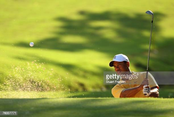 Tiger Woods hits a bunker shot during a practice round prior to the start of the 89th PGA Championship at the Southern Hills Country Club on August...