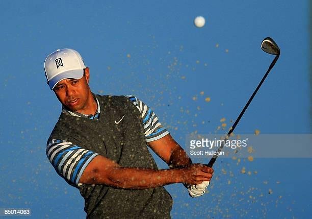 Tiger Woods hits a bunker shot during a practice round prior to the start of the Accenture Match Play Championship at the Ritz-Carlton Golf Club at...