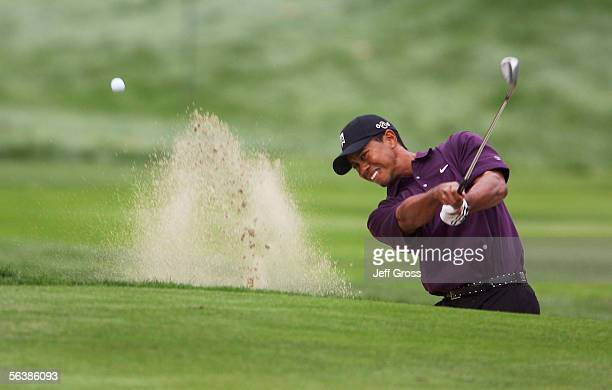 Tiger Woods hits a bunker shot to the sixth green during the first round of the Target World Challenge at the Sherwood Country Club on December 8...