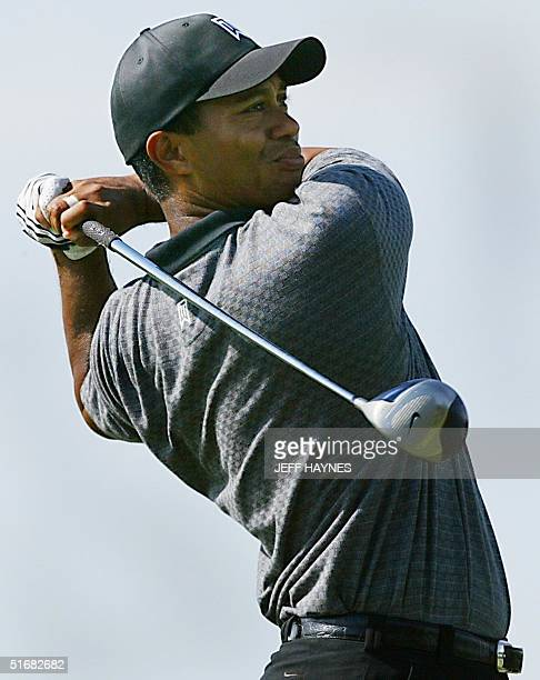 Tiger Woods hits a drive during his practice round for the 2002 PGA Championship13 August 2002 at Hazeltine National Golf Club in Chaska MN The 84th...