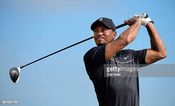 Tiger Woods hits a drive on the ninth hole during the first round of the Hero World Challenge at Albany course on December 1 2016 in Nassau Bahamas
