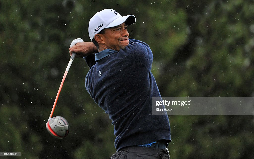 Tiger Woods hits a drive on the ninth hole during the second round of the Farmers Insurance Open at Torrey Pines Golf Course on January 25, 2013 in La Jolla, California.