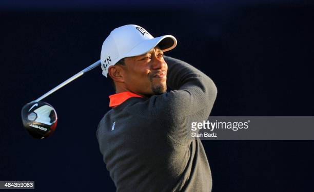 Tiger Woods hits a drive on the seventh hole during the ProAm round for the Farmers Insurance Open at Torrey Pines Golf Course on January 22 2014 in...