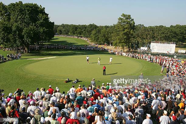 Tiger Woods hits a putt on the 18th green during the final round of the 89th PGA Championship at the Southern Hills Country Club on August 12 2007 in...