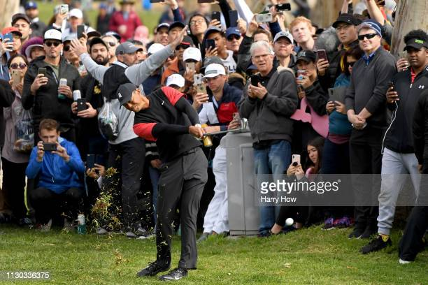 Tiger Woods hits a second shot on the 12th hole during the final round of the Genesis Open at Riviera Country Club on February 17 2019 in Pacific...